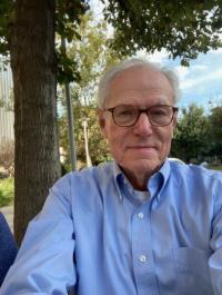 Dr. Charles  Titus