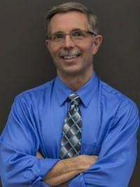 Mark E. McGuire