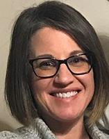 Misty Rhoads wearing glasses with black frames